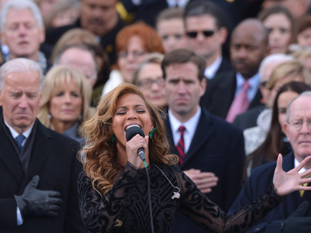 Beyonce performs the National Anthem as then-U.S. Sec. of State Hillary Clinton looks on in the background at the ceremonialswearing-in of President Obama in 2013